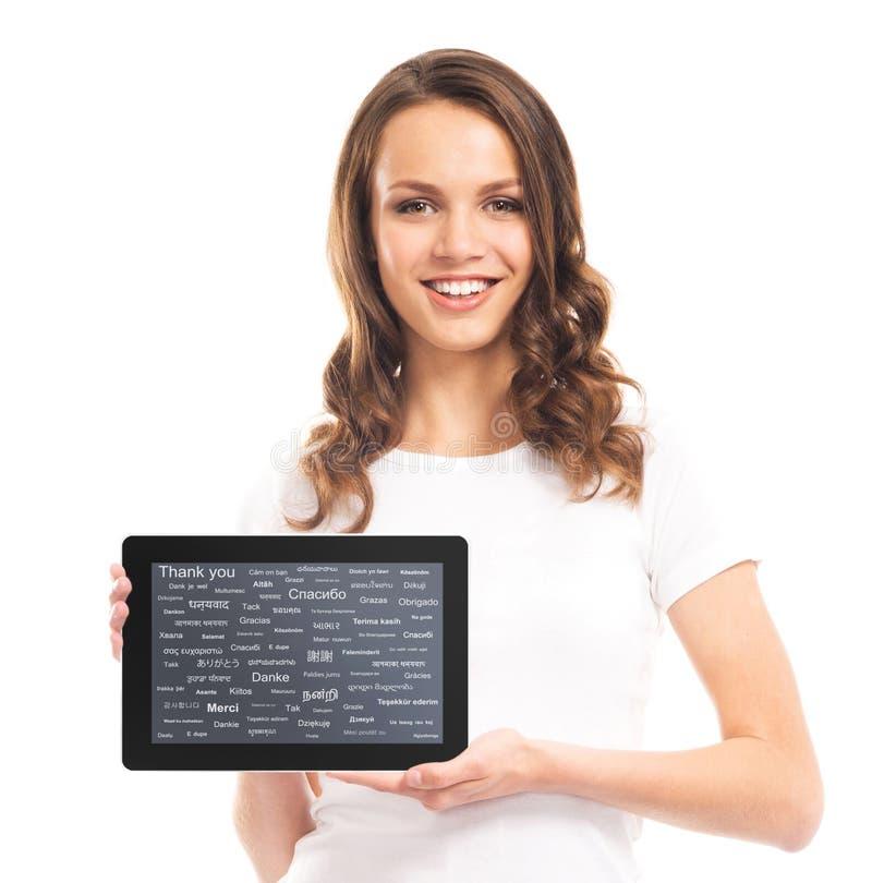 Tienermeisje met een tabletcomputer Verschillende wereldtalen royalty-vrije stock afbeeldingen