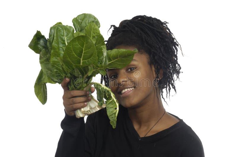 Tienermeisje met groenten royalty-vrije stock afbeelding