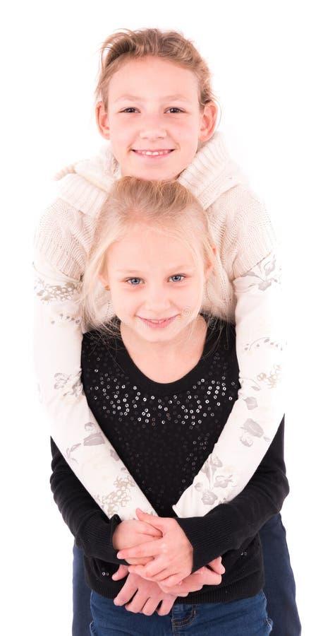2 tienermeisjes op een witte achtergrond royalty-vrije stock fotografie