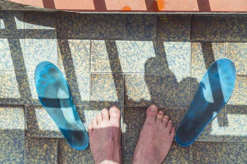 Tiered feet after hiking. And two shoe inlays stock images