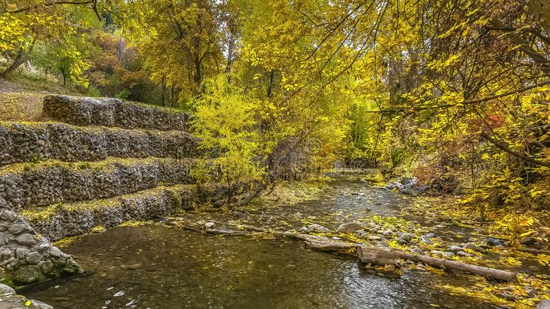 Tiered screened in rocks on a shallow stream bank. Tiered screened in rocks lining a shallow stream to protect the bank from erosion. Salt Lake City views with stock images