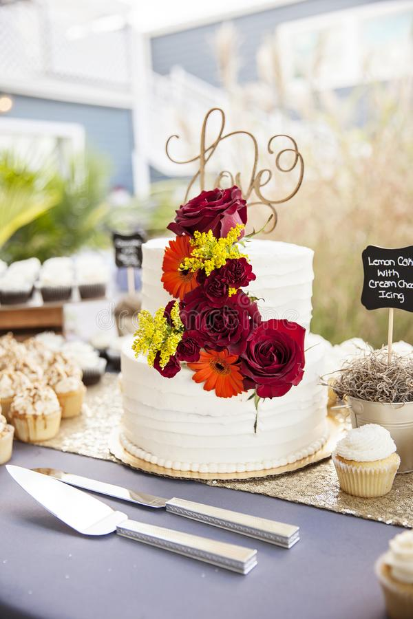 Wedding cake on table at garden wedding royalty free stock images