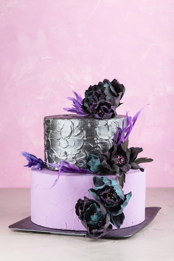 Tiered Wedding Cake With Black Fake Flowers Stock Image - Image of ...