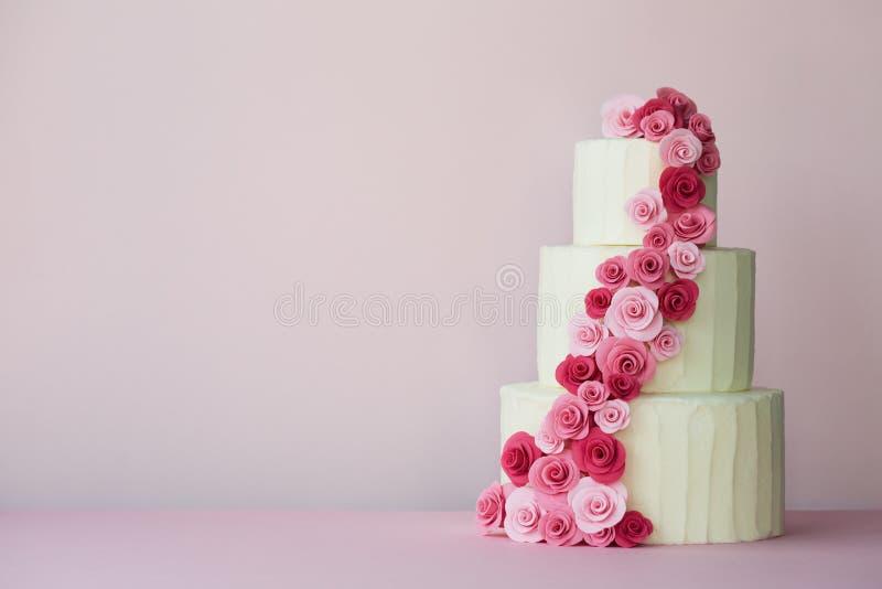 Tiered wedding cake with sugarpaste roses stock photos