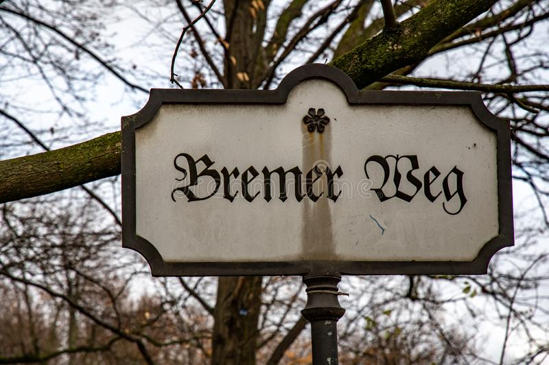 Antique nameplate in Tiergarten park of Berlin Germany. Old rusty sign with letters in gothic style. Vintage pointer. Tiergarten public park of Berlin Germany stock image