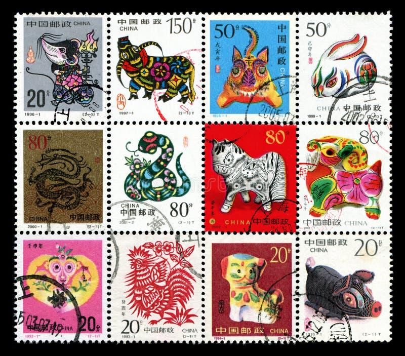 Tierkreis-Briefmarke mit 12 Chinesen stockbild
