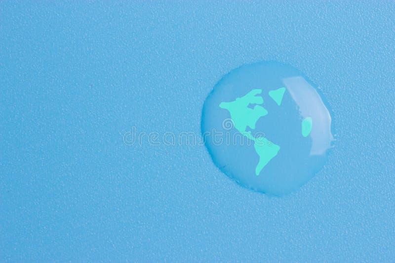 Tierra del planeta en un descenso del agua imagenes de archivo