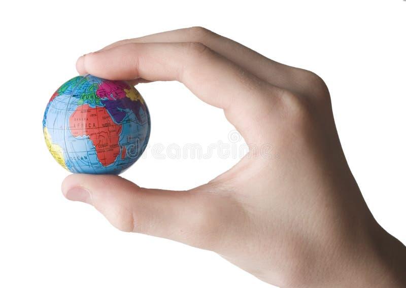 Tierra en la mano foto de archivo