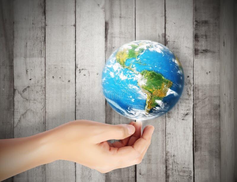 Tierra en mano humana contra stock de ilustración