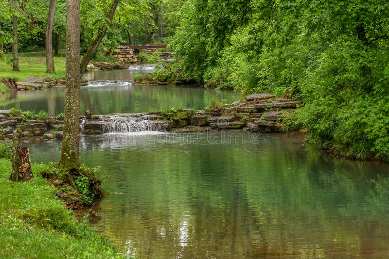 Tiers of cascading water along small stream. In canyon park stock photography