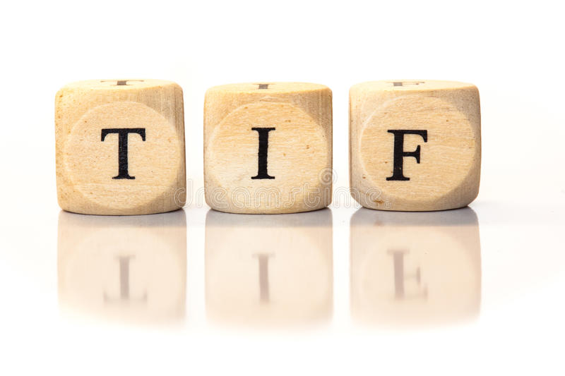 TIF spelled word, dice letters with reflection. Term TIF spelled from toy cubes, dice letters with reflection on bottom. Studio shot on White background royalty free stock images