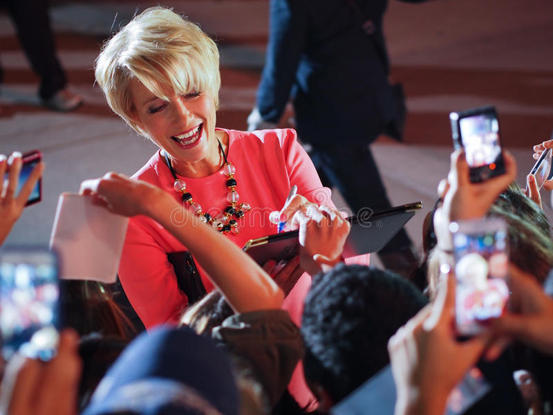 TIFF 2013. TORONTO - SEPTEMBER 12: Actress Emma Thompson signs autograph for fans at the Toronto International Film Festival for her new film The Love Punch on royalty free stock photos
