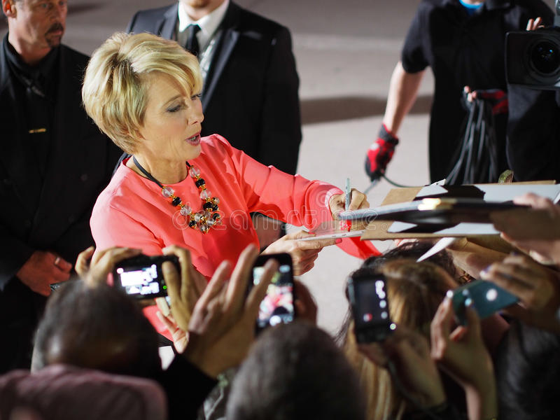 TIFF 2013. TORONTO - SEPTEMBER 12: Actress Emma Thompson signs autograph for fans at the Toronto International Film Festival for her new film The Love Punch on royalty free stock photography