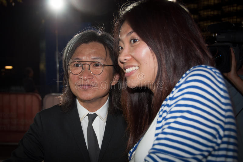 TIFF 2013. TORONTO - SEPTEMBER 10: Director Peter Chan Ho-sun takes a photo with fan at the Toronto International Film Festival for his film American Dreams in stock images