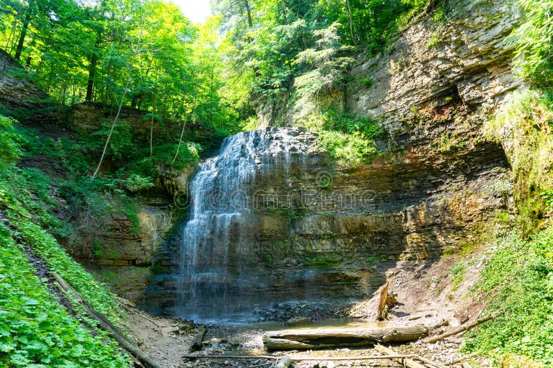 Tiffany Falls, Hamilton Ontario in the summertime. Tiffany falls in Hamilton, Ontario during the summer time beautiful green leaves stock photo