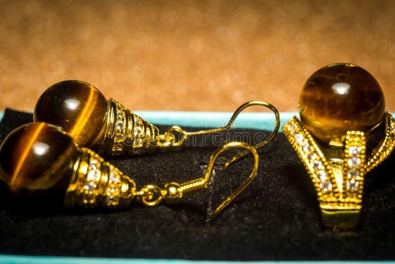 Tiger eye earrings stock photography
