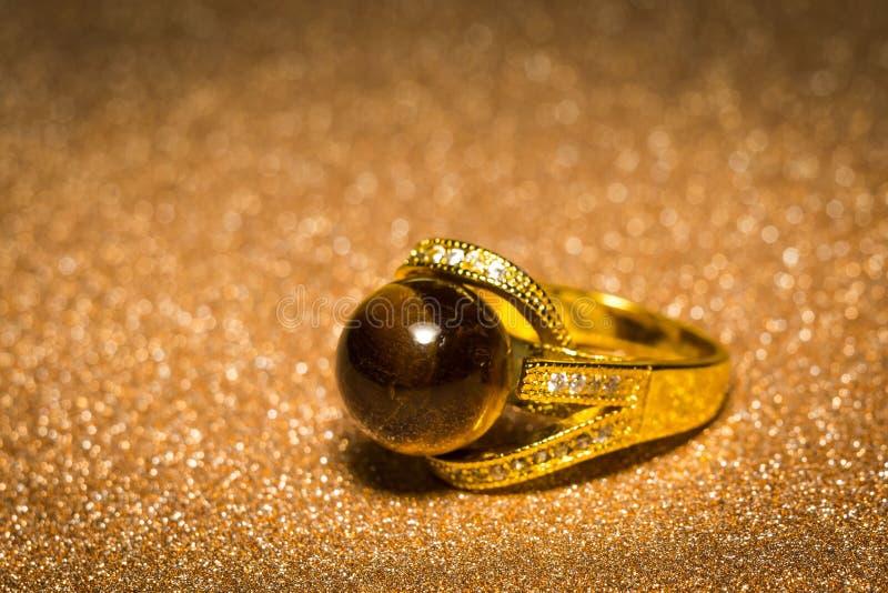 Tiger eye gold ring royalty free stock images