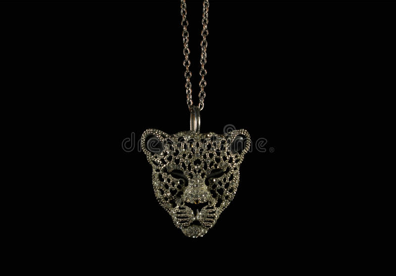 Tiger face jewelry photo. Tiger face jewelry pendant on black background photo stock photo