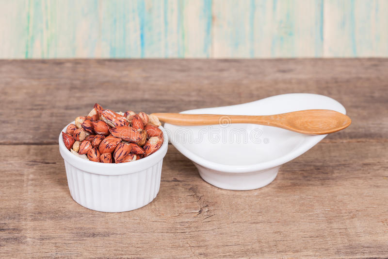 Tiger peanut in bowl on wood stock photos