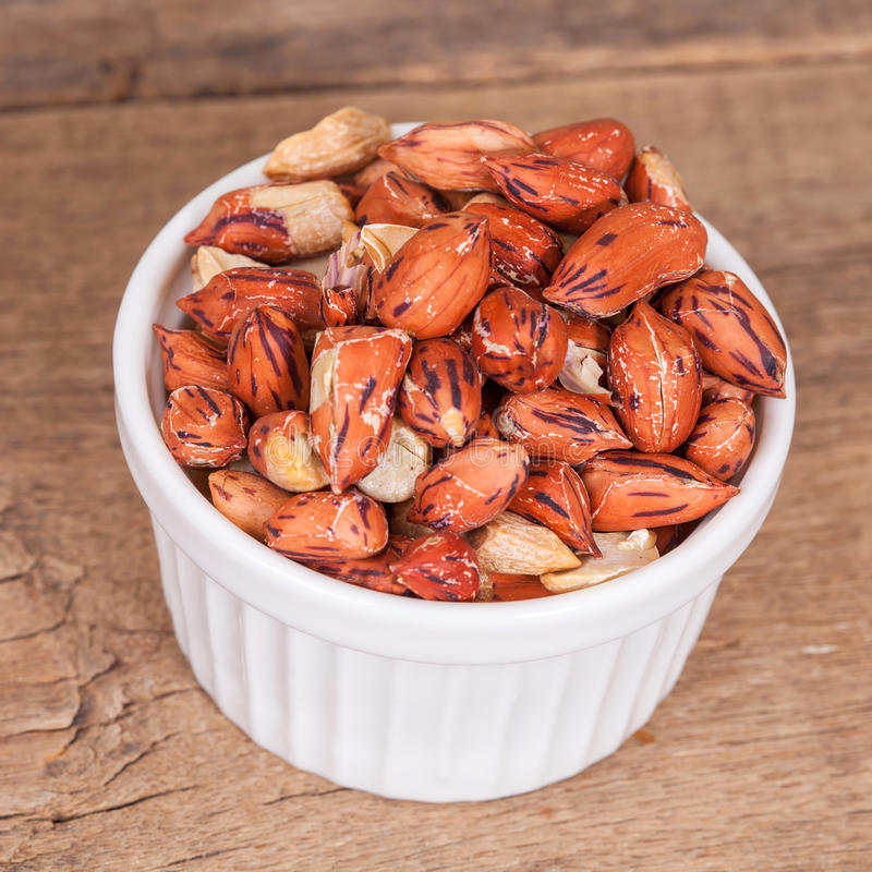 Tiger peanut in bowl on wood royalty free stock images