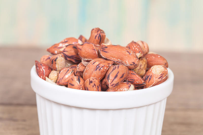Tiger peanut in bowl on wood stock photography