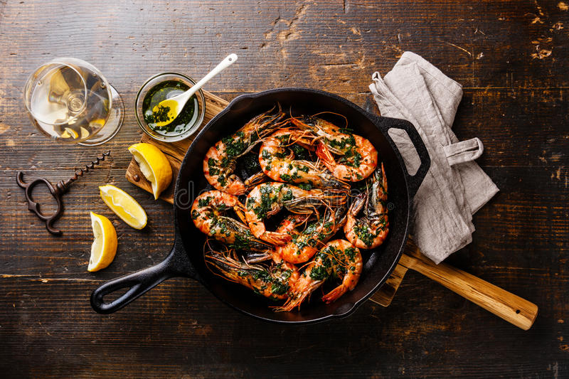 Tiger prawns on frying pan and wine stock photos