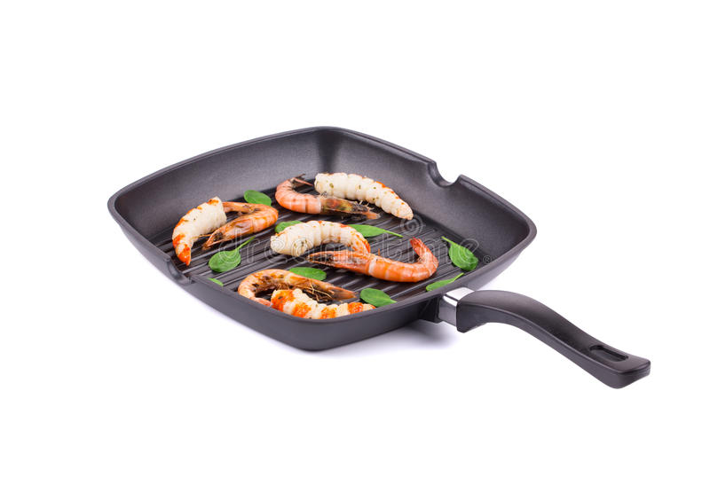 Tiger shrimps. On black pan. on a white background royalty free stock photo