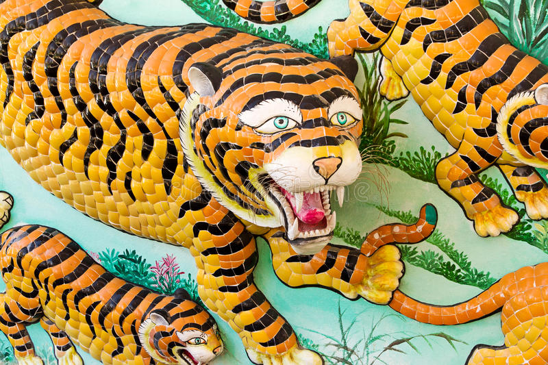 Tiger statue on Chinese temple wall royalty free stock photo