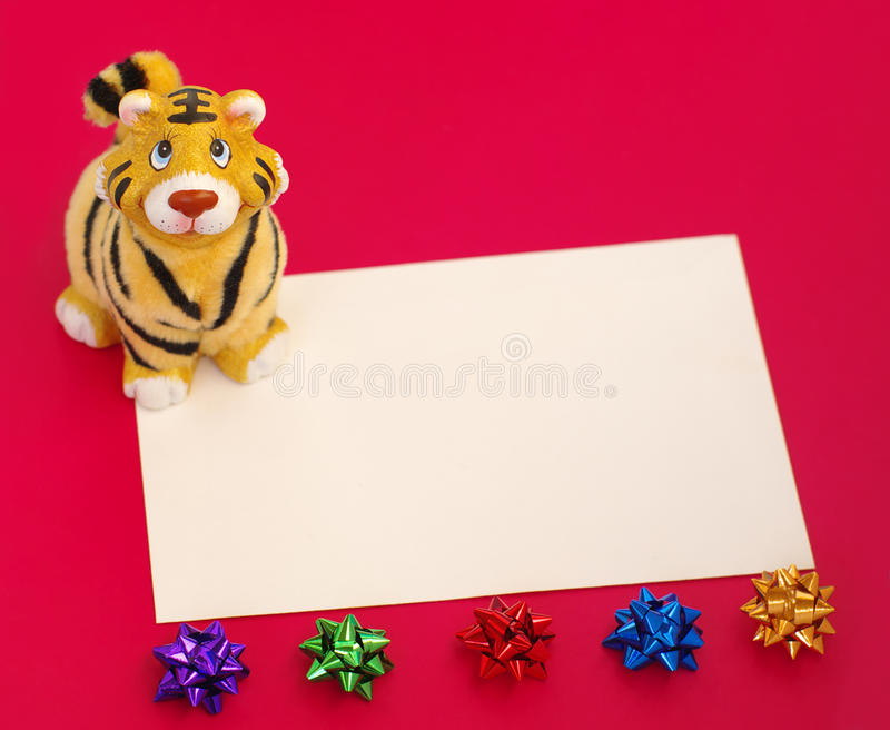 Tiger statuette and blank on red. Olly tiger figurine,form and ornamentals royalty free stock images