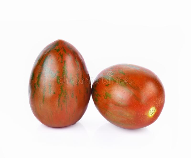 Tiger tomatoes on white background royalty free stock photography