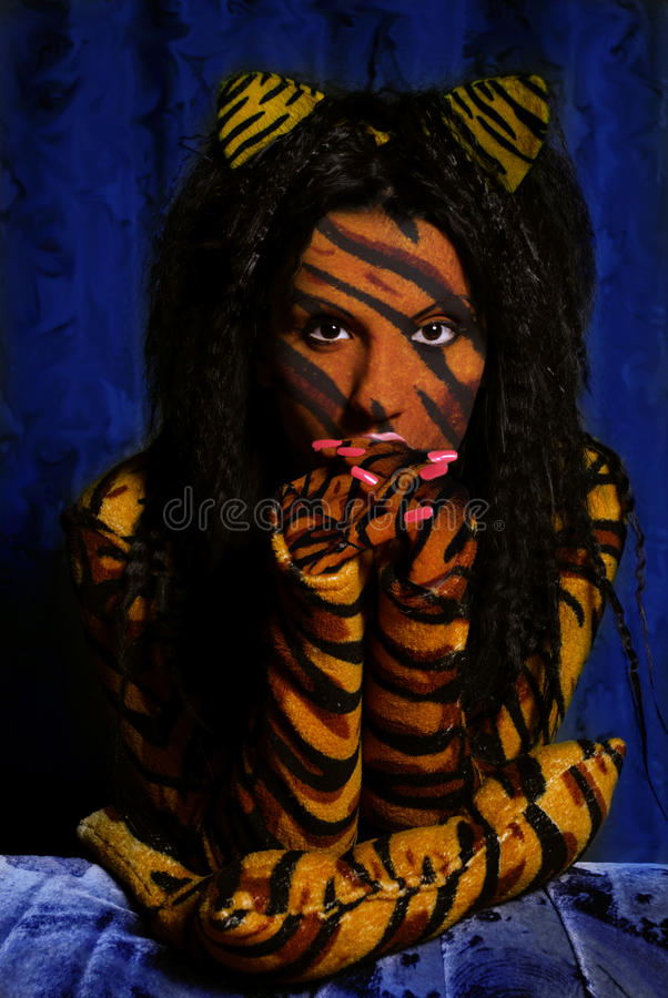 Tiger woman. Young beauty tiger woman portrait royalty free stock photography