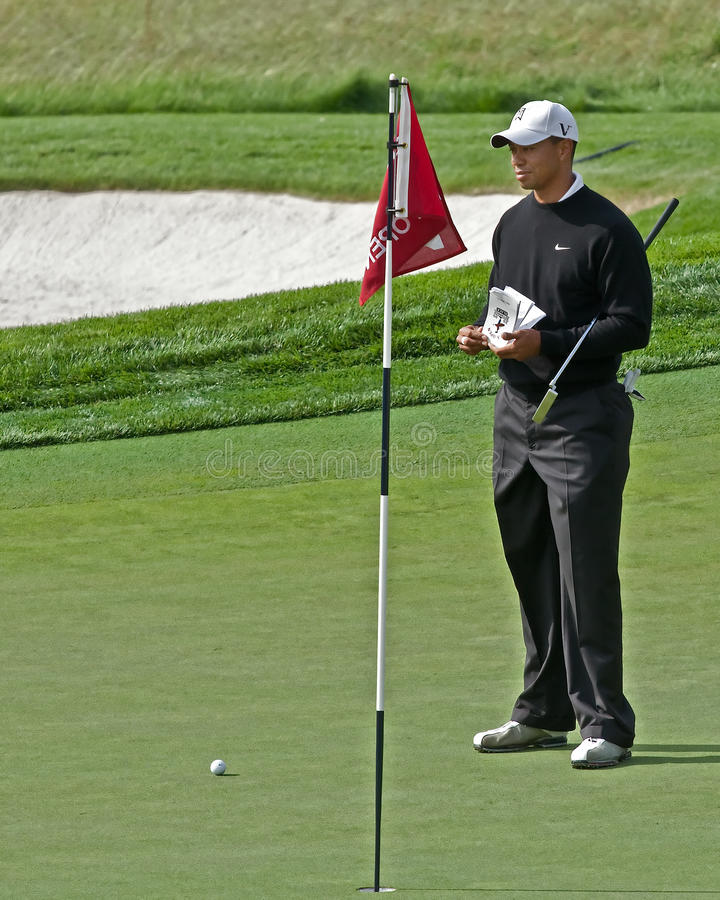 Tiger Woods. FARMINGDALE, NY - JUNE 16: Tiger Woods surveys the difficult 17th green on the Black Course during the 2009 US Open on June 15, 2009 in Farmingdale royalty free stock photography
