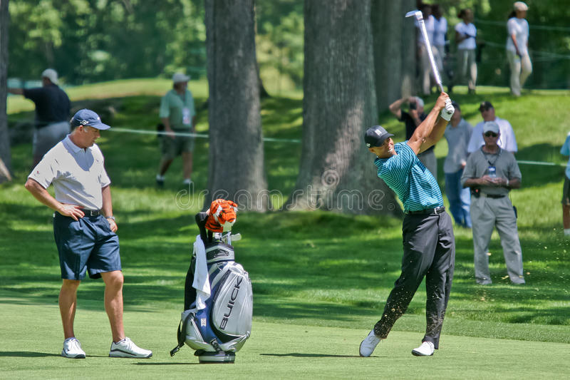 Tiger Woods. MAMARONECK, NY - JUNE 13: Tiger Woods hits an approach shot as he prepares to play, but missed the cut, in the 2006 US Open at Winged Foot on June stock photography