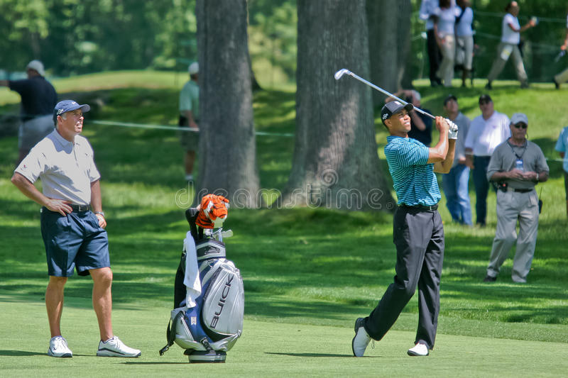 Tiger Woods. MAMARONECK, NY - JUNE 13: Tiger Woods hits an approach shot as prepares to play, but missed the cut, in the 2006 US Open at Winged Foot on June 13 royalty free stock images