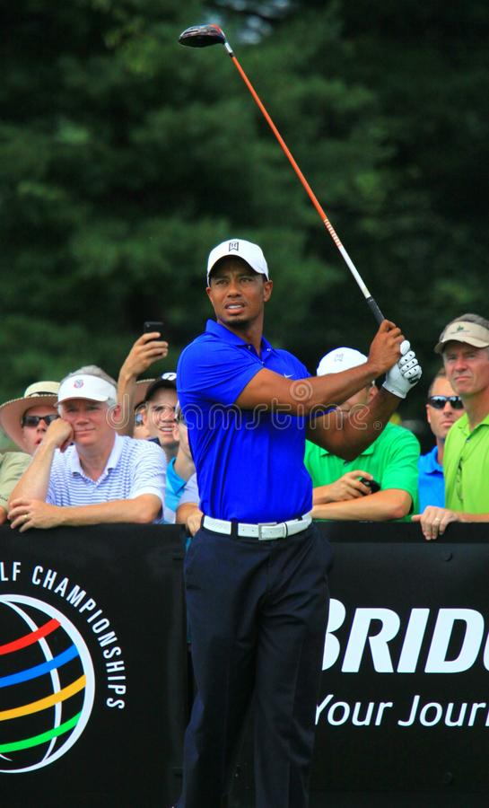 Tiger Woods in the tee box. Tiger Woods watch his ball at the tee box. Crowd is watching at the golf event royalty free stock photography