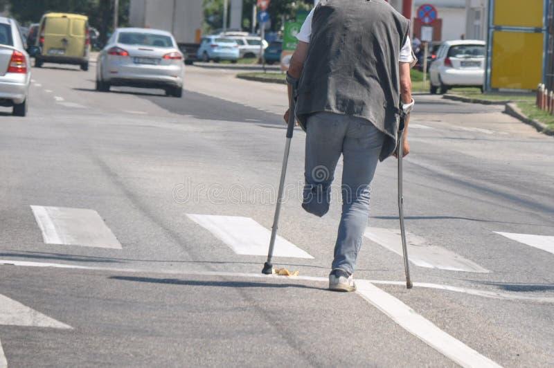Tiggare med ett ben arkivbild