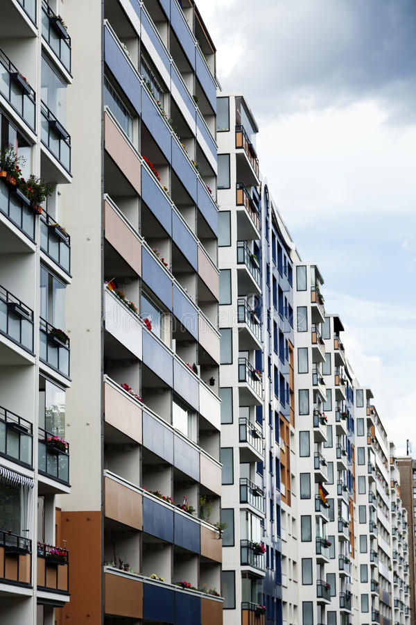 Colorful East Berlin Block. Tight block of buildings in various colors on an inclement day in Heinrich Heine Street, East Berlin, Germany royalty free stock photos