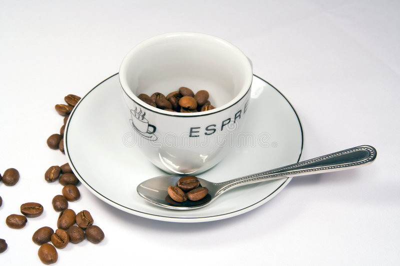 Download Tight Closeup Of Espresso Cup And Saucer With Beans Stock Photo - Image: 196002