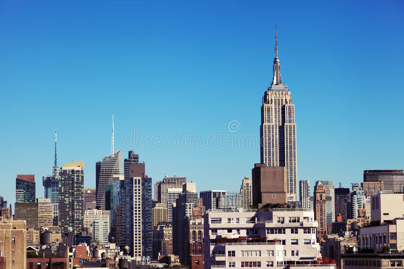 Empire State Building Midtown Manhattan Skyline New-York. The tight cluster of skyscrapers habitating midtown Manhattan with the famous Empire State Building royalty free stock photography