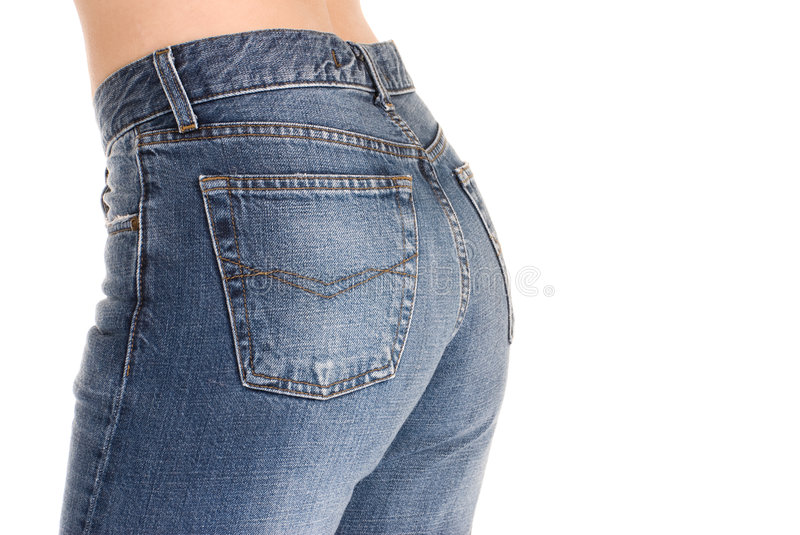 Tight fitting jeans. Beautiful buttocks in tight fitting jeans royalty free stock photography