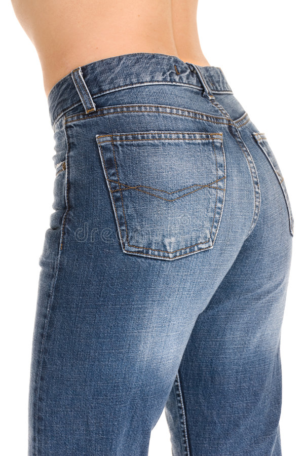 Tight fitting jeans. A young woman with her tight fitting jeans royalty free stock image