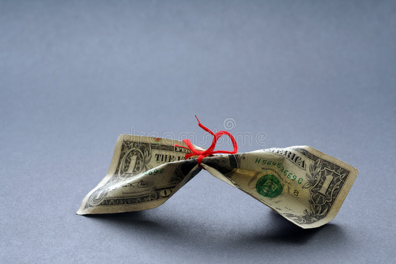 Tight money. Money tied with a thread, symbolizes tight money or save money royalty free stock images