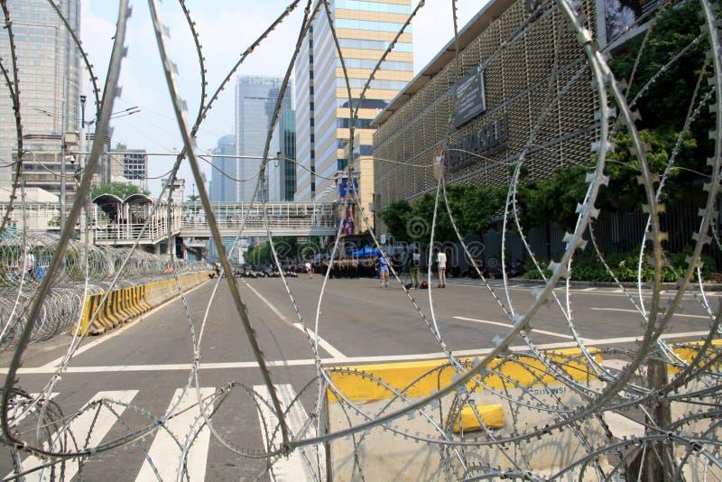 Tightened security. Jakarta, Indonesia - May 21, 2019: Indonesian National Police tightened security  of the Elections Supervisory Agency Bawaslu headquarters on stock photos
