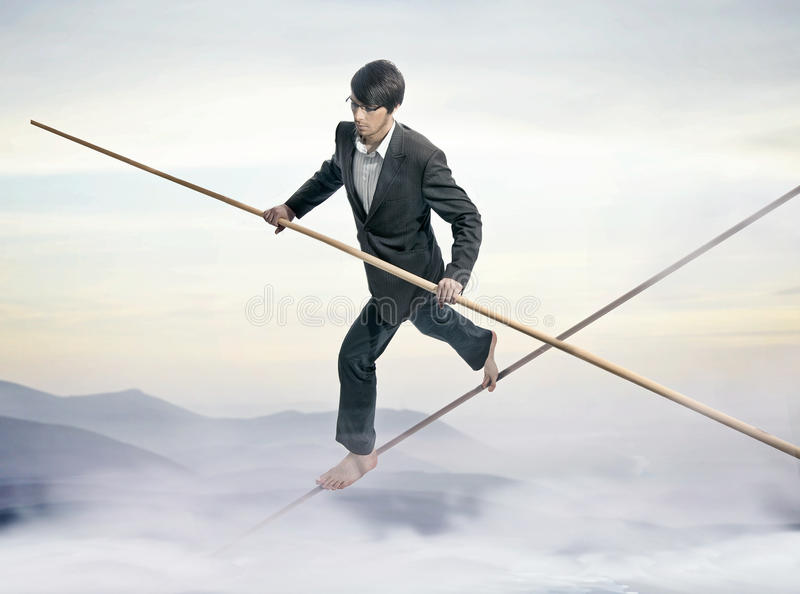 Tightrope. Businessman running a tightrope,handsome men