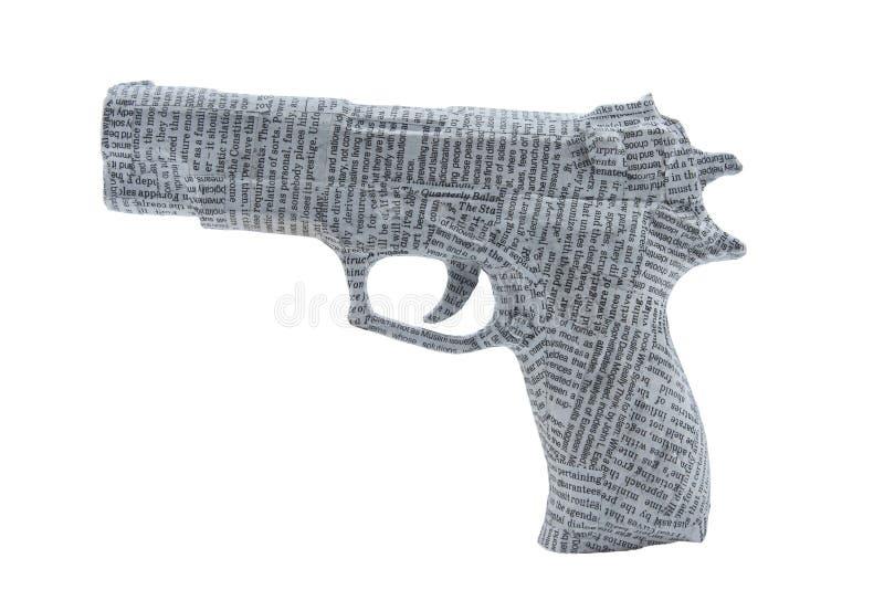 Tightyl de la arma de mano envuelto en periódico foto de archivo libre de regalías