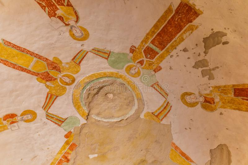TIGRAY, ETHIOPIA – January 27, 2019: iconographic wall murals of saints in Daniel Korkor church. Inside the Rock-hewn Churche Daniel Korkor in the region stock photos