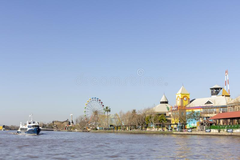 Tigre Buenos Aires State/Argentina 06/18/2014.Boat sailing in Parana Delta and the right amusement park Tigre Buenos Aires stock photo