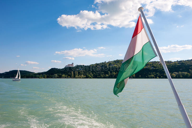Tihany Abbey and the Hungarian flag viewed from a ship at Lake Balaton stock photo