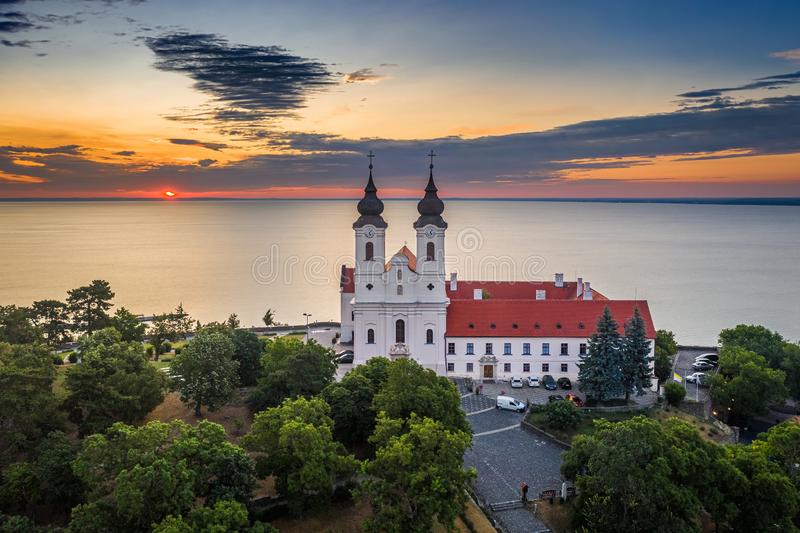 Tihany, Hungary - Aerial skyline view of the famous Benedictine Monastery of Tihany Tihany Abbey with beautiful colourful sky. And clouds at sunrise over Lake royalty free stock photography