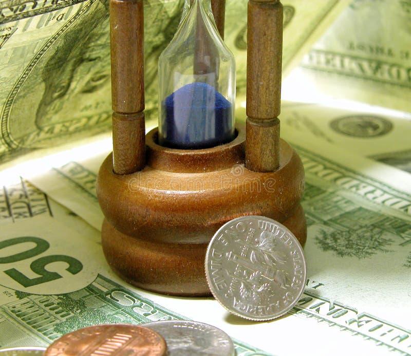 Tijd en geld stock afbeeldingen